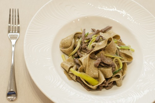 Coffee pasta with veal in cognac sauce