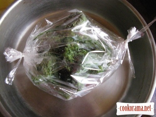 Dairy meat with broccoli in baking bag