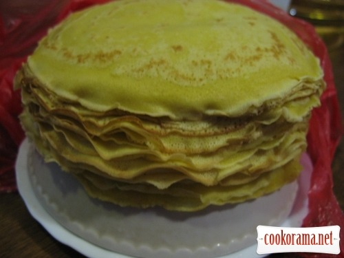 Pancakes with banana and curd, baked in a delicate cream
