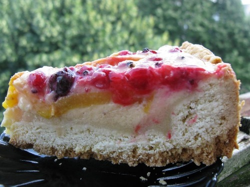 Shortbread sour cream-cake with fruits and berries