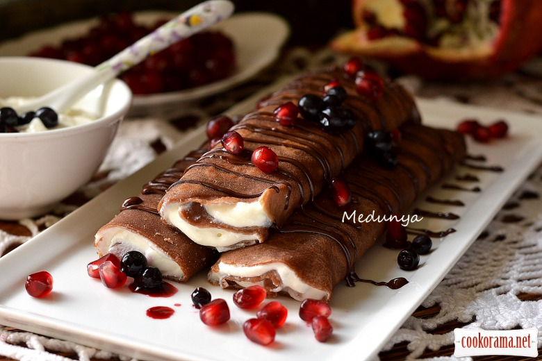 Coffee-chocolate pancakes with curd filling and chocolate sauce