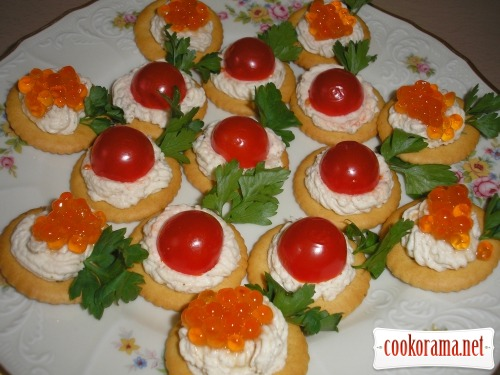 Canapes with cherry tomatoes and caviar