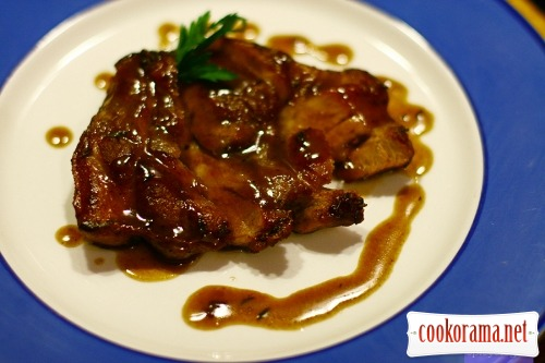Stake from pork neck with cognac sauce