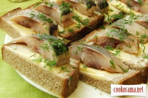 Snack canapes with dill and herring