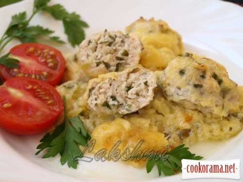 Zucchini casserole with chicken meatballs on grape leaves