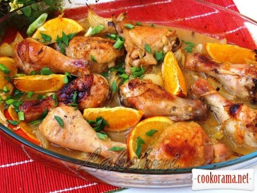 Chicken in oranges