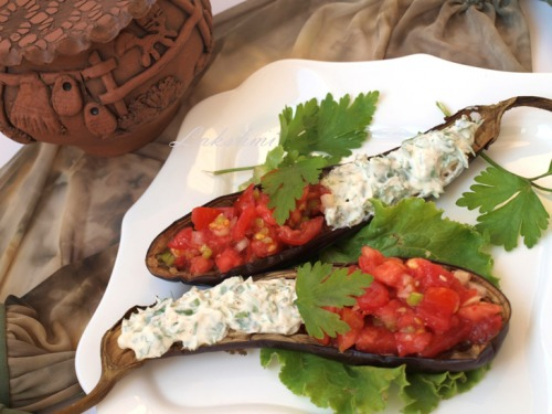 Baked eggplants with sour cream sauce and tomato salsa