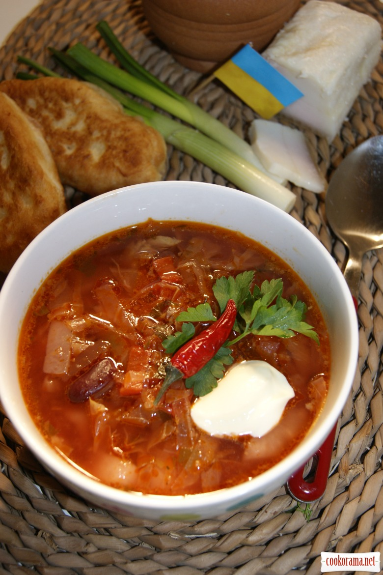 Ukrainian homemade borsch with dressing from lard and garlic