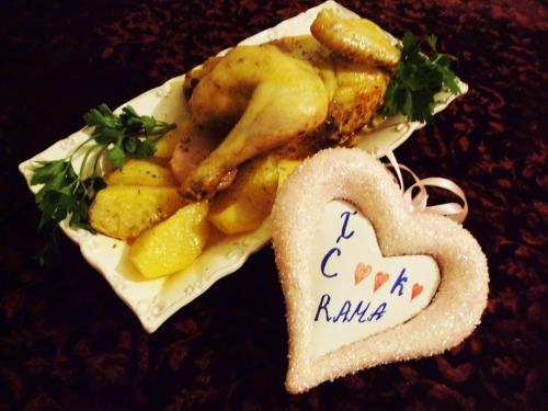 Курка, запечена з картоплею