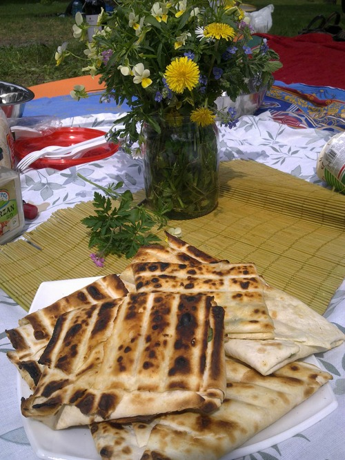 Lavash with brynza and greens on grill