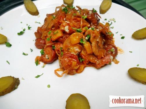 Sauerkraut stewed with vegetables, mushrooms, smoked sausage
