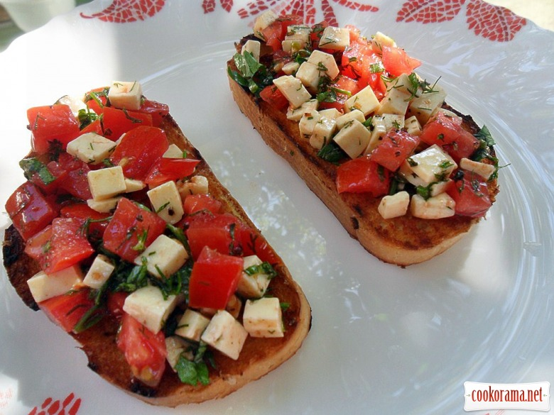 Bruschetta with cheese and tomatoes