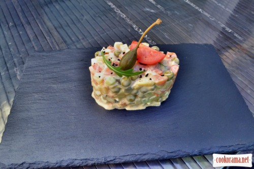 Olivier salad with salmon and spicy sauce