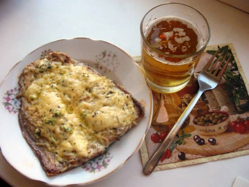 Mackerel with cheese, baked in the oven