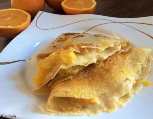 Pancakes with butter cream and oranges