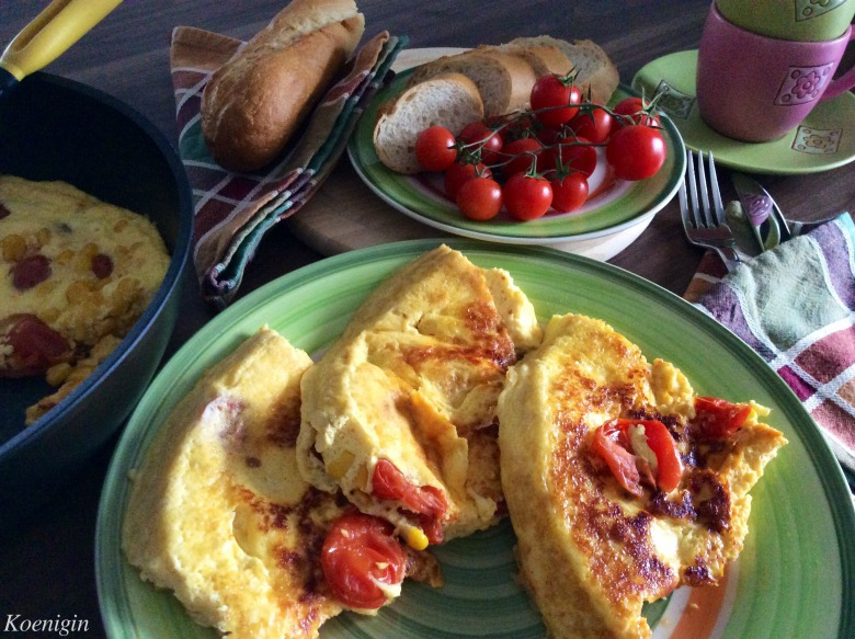 Omelette with cherry tomatoes and cheese