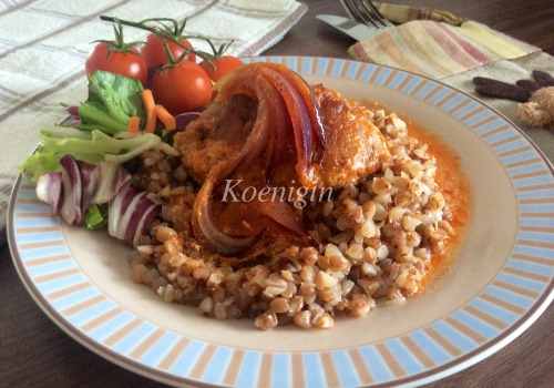 Meat patties, baked in tomato-cream sauce