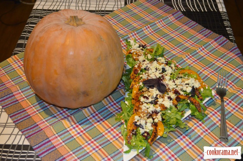 Salad from pumpkin, nuts and cranberries