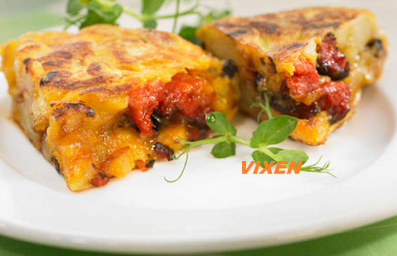 """""""Tortilla"""" (Spanish omelette with potatoes, chorizo and olives)"""