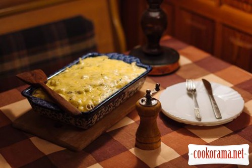 Pasta with pineapple under thick bechamel sauce with appetizing cheese crust